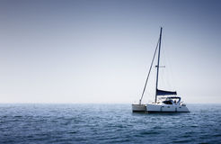 Sail Boat on the blue ocean Royalty Free Stock Photography
