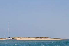 Sail boat and deserted island Royalty Free Stock Images