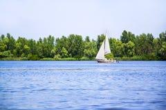 Sail boat on Dniper river Royalty Free Stock Photos