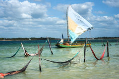 Sail boat and hammocks in Jericoacoara, Brazi Stock Photos