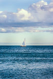 Sail boat on a lake Stock Photos
