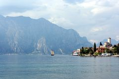 Sail boat on a lake near resort Malcesine Royalty Free Stock Photo