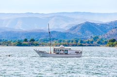 Sail boat on lake Pichola in Udaipur, India. stock photo