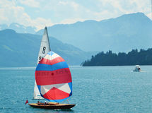 Sail boat in Lucerne lake switzerland in front of mountains Stock Images