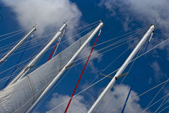 Sail boat masts. With blue sky stock photos