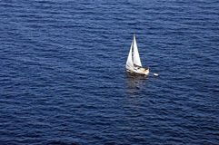 Sail Boat on the mediterranean in Mallorca. A boat sails across the mediterranean sea in Mallorca, Spain Royalty Free Stock Photo