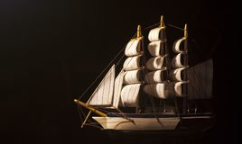 Sail boat. A sail boat model against a dark background Royalty Free Stock Image