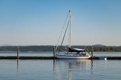 Sail boat moored at a dock Royalty Free Stock Images