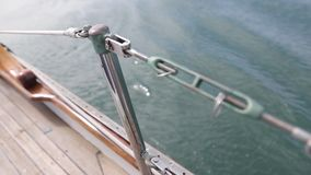 Closeup of the deck of a wooden antique Sail boat navigating in the ocean sunny day showing the wooden parts and. Sail boat navigating in the ocean sunny day stock video