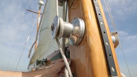 Sail boat navigating in the ocean sunny day showing the wooden parts and closeup of the sail of a wooden antique. Sail boat navigating in the ocean sunny day stock footage
