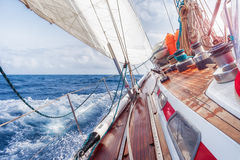 Sail boat. Navigating on the waves Stock Photos