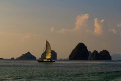 Sail boat near the island at Andaman Sea at sunset Royalty Free Stock Images