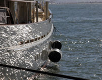 Sail boat with ocean glistening reflection Stock Image
