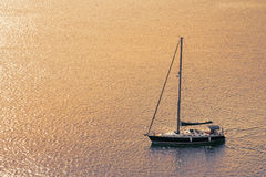Sail boat on the ocean with sunset for a concept background. Royalty Free Stock Photos