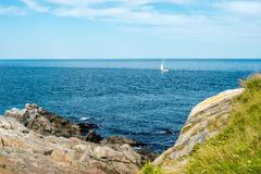Sail boat off the shoreline of Highlands National Park Royalty Free Stock Photos