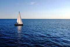 Sail boat on open sea. Stock Photo