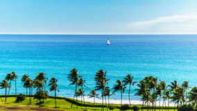 Sail Boat in the Pacific Ocean just off the coast at Ko Olina Royalty Free Stock Image