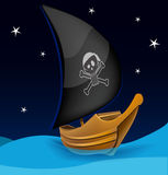 Sail boat with pirate symbol on a night background Stock Photos
