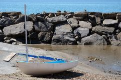Sail boat resting on sand Stock Images