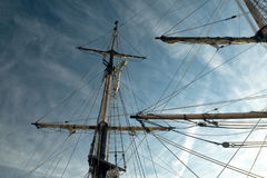 Sail boat rigging against dark blue sky. Tall ship rigging, mast and sail royalty free stock images