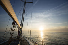 Sail Boat Sailing In Sea During Sunset Stock Photography