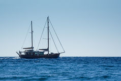 Sail boat sailing on a sunny day Stock Image