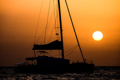 Sail Boat Silhouette  at Sunset Stock Photo