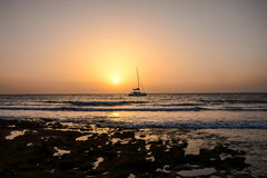 Sail Boat Silhouette  at Sunset Stock Photos