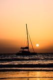Sail Boat Silhouette  at Sunset Stock Images