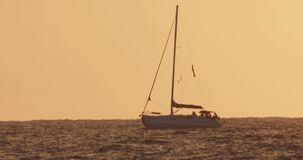 Sail boat silhouette, super telephoto footage stock video