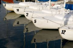 Sail Boat - Skiffs in Harbor. Numbered small sail boats in harbor stock image