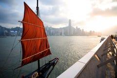 Sail-boat stands at the waterfront of Hong Kong. Sailing boat stands at the waterfront of Hong Kong at sunset. September, 2011 Stock Photo