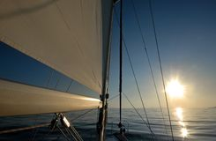 Sail boat at sunset stock photography