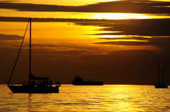 Sail boat at the sunset. The golden sunset over Pacific Ocean, Vancouver, British Columbia, Canada stock image