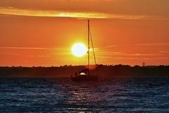 Sail boat at sunset royalty free stock images