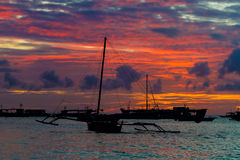 Sail boat at sunset sea, boracay, philippines Stock Image