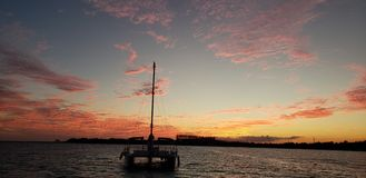 Sail boat in the sunset royalty free stock photo