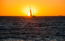 Sail Boat at Sunset on Water Stock Image