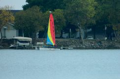 Sail boat on the lake in Twin Lakes Iowa. Sail boat image during the summer on Twin Lakes in Iowa United States Royalty Free Stock Images