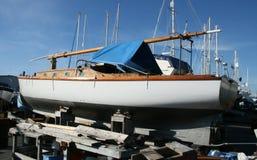 Sail Boat Under Repair. Repairing/restoring a vintage 1926 sailboat to its original condition Royalty Free Stock Image