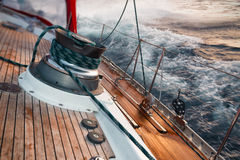 Sail boat under the storm. Detail on the winch stock image