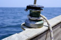 Sail boat winch with marine rope arround Royalty Free Stock Images