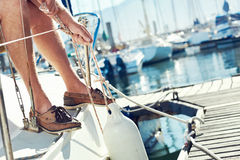 Sail boat  yacht mooring. Portrait of senior man tying knot and securing a mooring for his hobby yacht sail boat Stock Photography