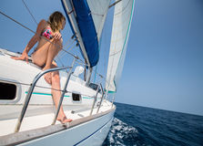 Sail boat. Young lady relaxing on the sail boat in the tropical sea at sunny day Stock Photo