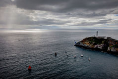 Sail boats around South Stack lighthouse Stock Photography