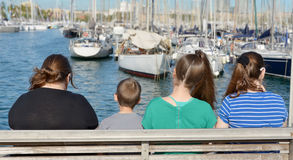 Sail boats in Baecelona Port Harbor. A family looking at the many sail boats anchored in Barcelona Port Harbor, Spain Royalty Free Stock Photography