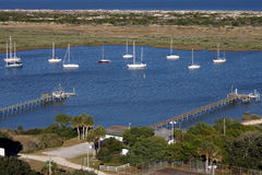 Sail Boats in the bay. Docked near piers Royalty Free Stock Photo