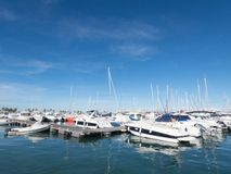 Sail Boats on a beautiful cloudless day in the marina stock photography