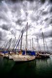 Sail boats docked in the marina stock photos