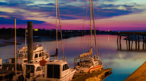 Sail boats docked on marine in beautiful sunset. Sail boats and yachts docked on marine in beautiful sunset sky, horizontal photo taken at evening just after Royalty Free Stock Photos